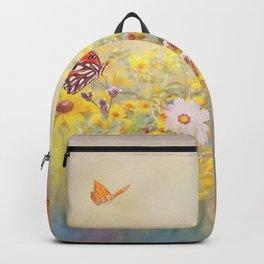 Gulf Fritillary butterflies in a meadow Backpack