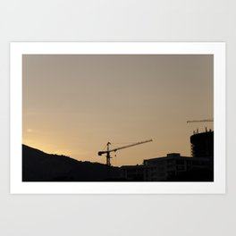 construction cranes at sunset Art Print