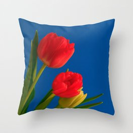Three Tulip Flowers on Blue Background Throw Pillow