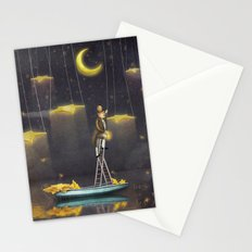 Man reaching for stars  at top of tall ladder Stationery Cards