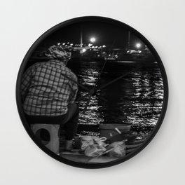 Fisherman in the night Wall Clock