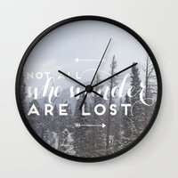 not all who wander Wall Clocks featuring Not all who wander... by E. Phillips - Creative Designer