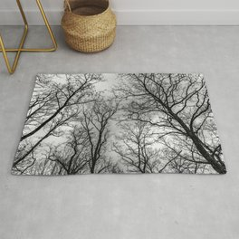 Flying tree branches, black and white Rug