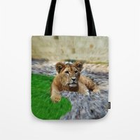 the lion king Tote Bags featuring King Lion by helsch photography