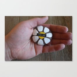 Love you-hand holding rock painted with a daisy motif Canvas Print