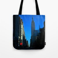 gotham Tote Bags featuring Gotham City by The Electric Blve / YenHsiang Liang