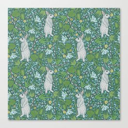 Grey hares with coltsfoots and snowdrops on green background Canvas Print