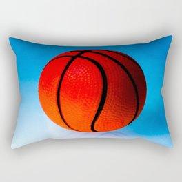 Orange Basketball Ball Against The Blue Background Rectangular Pillow