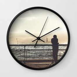 Lady Liberty, my man, some fisher people. Wall Clock