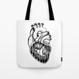 A caged bird Tote Bag