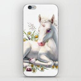 Baby unicorn lies in flowers iPhone Skin