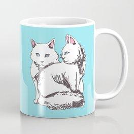 White Maine Coon Cats with Light Blue Coffee Mug