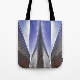 Architectural abstract of a metal clad building looming in symmetry. Tote Bag