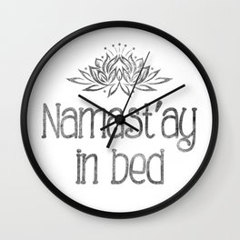 Namast'ay in bed Wall Clock