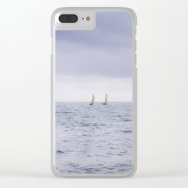 Sailing the ocean blue; two sailboats on the horizon Clear iPhone Case