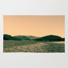 Sunsetting landscape photography of sky, lake and mountain. Rug