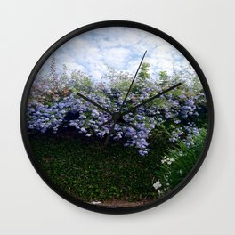 Blue flowers and skies Wall Clock