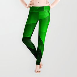 Repetitive overlapping sheets of dark green paper triangles. Leggings