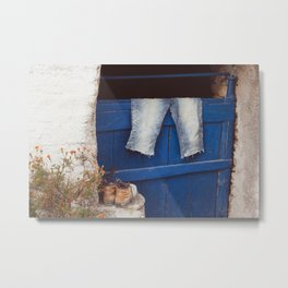 Still-life of workman's clothes on blue door in a Greek village   Travel photography from Greece.   Metal Print