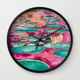 Ginger Cat amongst the Lily Pads on a Pink Lake Wall Clock