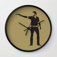 rick grimes Wall Clocks featuring Rick by the minimalist