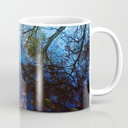 Trees reflected by water. Autumn, fall, maple leaves, blue Coffee Mug