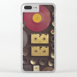 Music. Vintage wall with vinyl records and audio cassettes hung. Clear iPhone Case