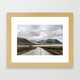 Iceland road trip with magical clouds and dramatic light Framed Art Print