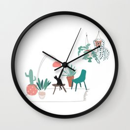 Cat relaxing in the living room among plants Wall Clock