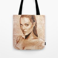 angelina jolie Tote Bags featuring Angelina Jolie by Renato Cunha