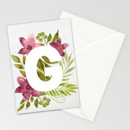 Monogram G with red waercolor flowers and green leaves. Floral letter G. Botanical illustration. Stationery Cards