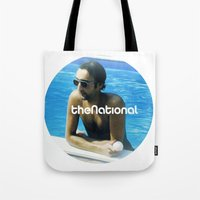 the national Tote Bags featuring National, The by iamomnipotent