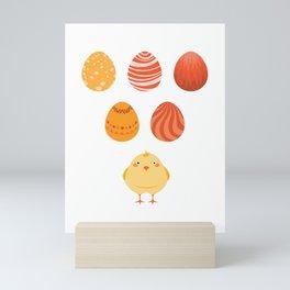 A cute chick and eggs Mini Art Print