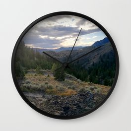 Light through clouds - A mountains scene Wall Clock