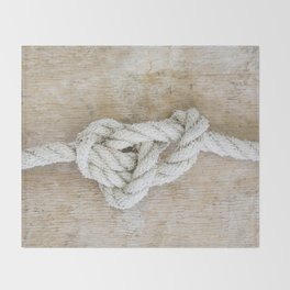 Knot on driftwood Throw Blanket