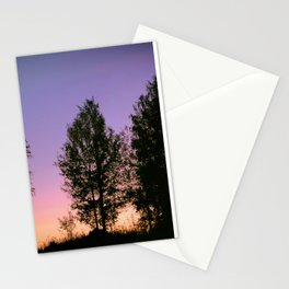 Nightfall. Purple and pink sky in the forest after sunset. Stationery Cards