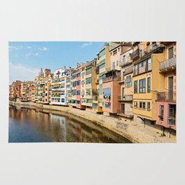 Colorful houses and reflected in water in Girona Rug