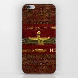 Golden Egyptian God Ornament on red leather iPhone Skin