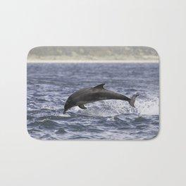 Jumping (breaching) Wild bottlenose dolphin tursiops truncatus. Bath Mat