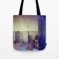 toronto Tote Bags featuring Toronto by Jordan Osbourne