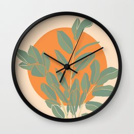 The Large Plant And The Full Orange Sun Wall Clock