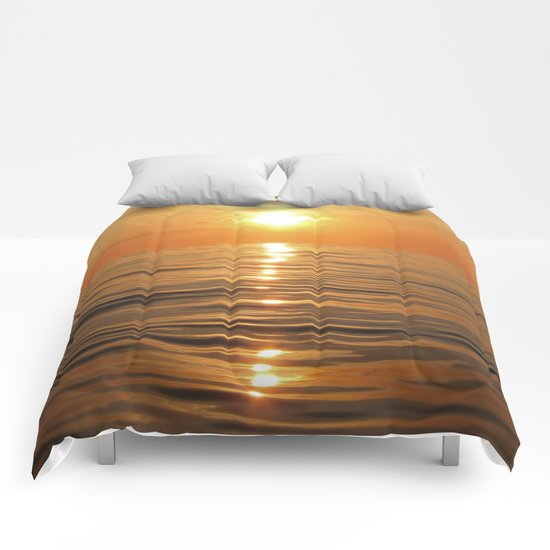 Sun setting over calm waters Comforters