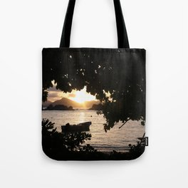 Sunset framed by leafs Tote Bag