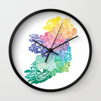 ruben ireland Wall Clocks featuring Typographic Ireland by CAPow!