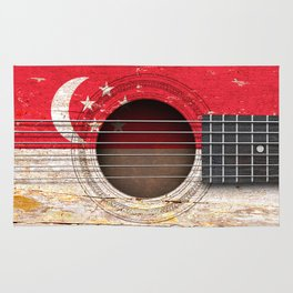 Old Vintage Acoustic Guitar with Singapore Flag Rug