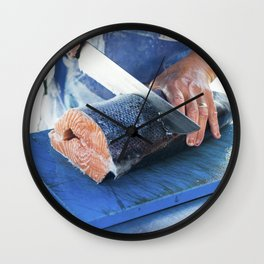 Fresh salmon being sliced at a market Wall Clock