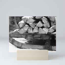 Sled with firewood, black and white photo Mini Art Print