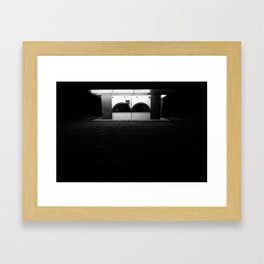 Lonely in the dark with only a light to shine Framed Art Print