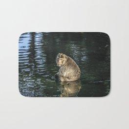 Monkey in the water Bath Mat