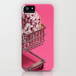 Macro shoot of white donut in shopping trolley over pink background iPhone Case